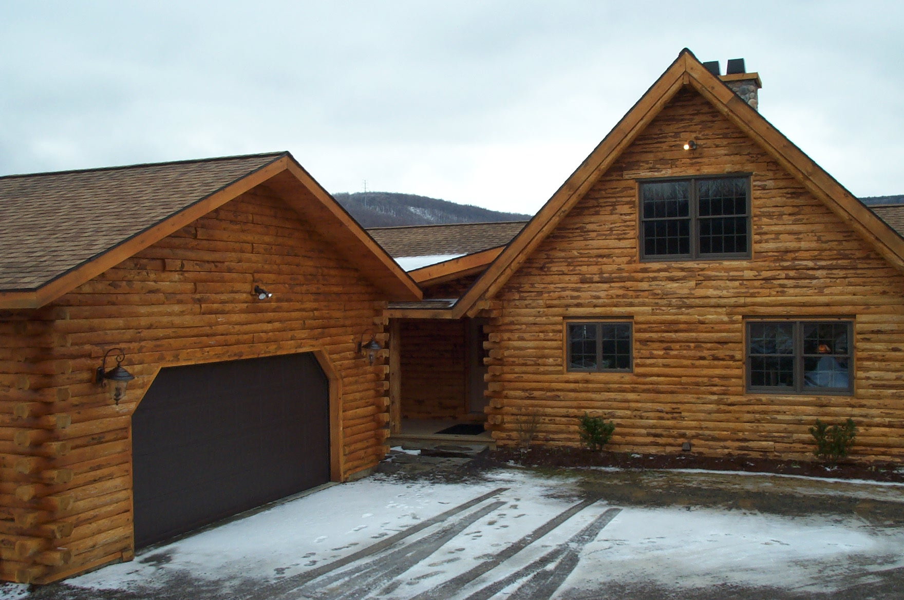 18 spectacular log home garages architecture plans 19800 for Log cabin house plans with garage